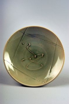 Richard Burkett | Untitled plate, 1975-79; purchased in Bainbridge, Indiana; porcelain, Celadon with trailed decoration; Gift of American Ceramic Society Collection