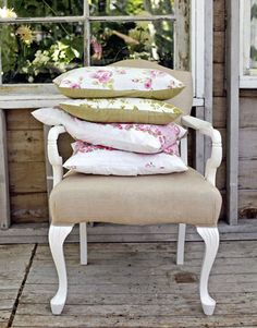 "Oil-based white paint and three yards of linen upholstery gave new life to this dated chair found at a garage sale. ""I like recycling things,"" says Heather.   - HouseBeautiful.com"