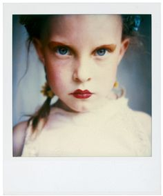 """Sibylle Bergemann, Polaroids. """"The expression of a little girl with red painted lips is a predestination: In her eyes is the look of the woman who she would like to become,  and the expression of the child that has the pull of seduction""""- Julie Voigt"""
