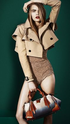 British model Cara Delevingne carrying the directional Blaze bag in the latest Burberry S/S13 campaign