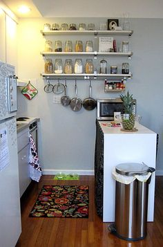 Tiny kitchen.  Make open storage look nice with grains and such in mason jars