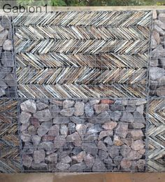 Cornish slate stacked in a herringbone pattern inside the gabion http://www.gabion1.co.uk