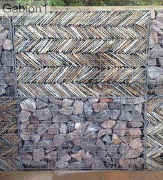 Cornish slate stacked in a herringbone pattern inside the gabion http://www.gabion1.co.uk
