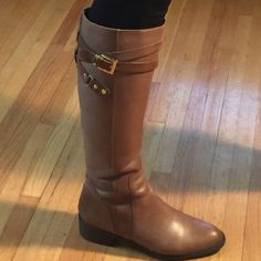 Charcoal leather boots Has brown straps on top of boot with gold buckle and zipper goes all the way up on the side. Excellent condition, very soft leather and lining is suede. Warm boots for winter and very stylish Franco Sarto Shoes Winter & Rain Boots