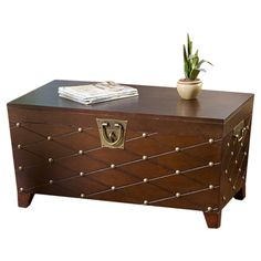 Trunk-style coffee table with a grooved diamond motif and interior storage.    Product: Coffee table Construction Mat...