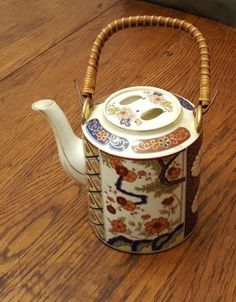 Satsuma Ceramic Teapot painted with cherry blossoms & lotus flowers with a bamboo handle by CnWsTexasTreasures on Etsy