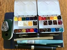 watercolor journaling sketchbook - Google Search...Nice little watercolor palettes. I bought one a while back from Wet Paint Art, but I don't think they sell them there anymore. They are so cool. The pans are 1/4 pans and you can fit a Sakura Koi water brush separated in the middle. Totally fits in the purse.