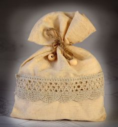 SET OF 25 Natural Rustic Ivory Linen Wedding Favor Bag or Gift Bag 5,5x7,5 inches with lace. $60.00, via Etsy.