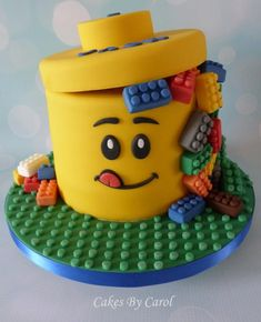 LEGO cake - to cut down on the fondant stuff, maybe just do a several layer cake frosted yellow, a smaller cake on the top, and then piping to draw the face