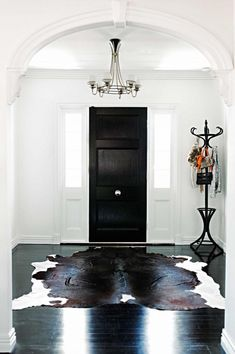 black white entry-cow-hide-rug-coat-stand-chelsea-de-luca