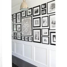 A great way to display many different photos is to make sure they're all black and white, and in a similarly colored frame.