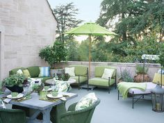 The Greystone estate has a delightful guest terrace with green furnishings that feel like they are part of the surrounding landscape.