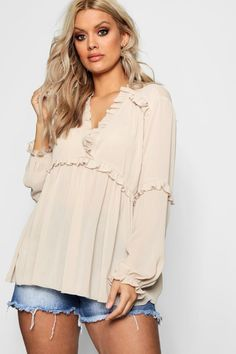 85e5c445d1 Click here to find out about the Plus Georgie Ruffle Detail Plunge Blouse  from Boohoo,