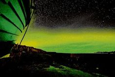 Northern Lights seen from Urris, Clonmany, Inishowen, Co. Donegal, Ireland -- supposed to be visible until March!!!!  Wish I were there!    Compliments of Irish Central - photo by Adam Porter