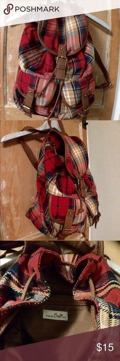 Cute Plaid Nap sack, back pack, purse This plaid backpack I perfect for a day trip or overnight vacation. The plaid has great colors and it is nearly brand new! There is a zippered pocket in the back and two little pockets in the front. Great for school! Bags Backpacks
