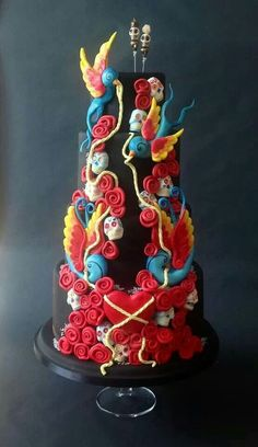 Black wedding cake with skulls and roses etc. Nice