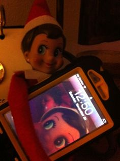 Elf on the shelf taking pictures. Love that my niece Madison is in the back ground:)