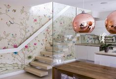 Wow.  The wallpaper, the stairs, those rose-gold colored globe pendant lamps.  Pretty girly, but modern and fresh at the same time.