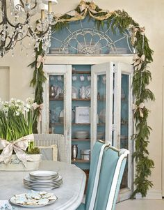 I love this gorgeous built in glass display cabinet and decked out for the holidays it's spectacular! Blue & White Holiday House In this 1890s New York City brownstone, buttery whites and robin's-egg blue are sparked with silver and gold for a romantic Christmas.