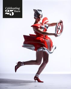 """A visit to the WOW car museum sparked Sarah Thomas' imagination after she encountered a red 1950's American roadster. Inspired by the tall tail fins, extravagant bumpers and layers of chrome, Sarah created her own wearable art classic """"American Dream"""" for the 2009 show. #Celebrating25Years"""