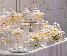 Candy favor bar - doubles as a fun and interactive feature for guests AND makes for lovely reception decor. Can be done rather inexpensively, too! Buffet Dessert, Lolly Buffet, Dessert Bars, Dessert Tables, Candy Bar Wedding, Wedding Sweets, Candy Table, Candy Buffet, White Candy Bars