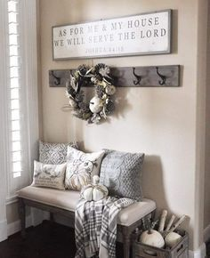 Thanksgiving decor - rustic farmhouse style, entry vignette with upholstered bench, pillows, wreath and pumpkins sets the perfect Fall mood.