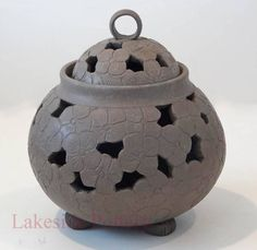 Carved incense jar with feet