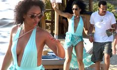 Lionel Richie's girlfriend shows off her curves in plunging swimsuit