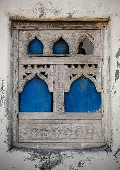lamaisondupoete:  Old wooden window in Mirbat - Oman by Eric Lafforgue on Flickr.Mirbat, like most of the sea towns in the province of Dhofa...