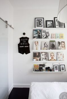 Shelving #decor. Display art books as decoration and mix in framed contemporary photographs for a modern chic look.