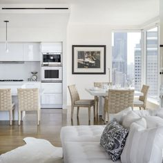 This snow white apartment is located in Seattle. There is the huge hall, connected to the kitchen and the dining room. The interior is light and airy. Living Room Bar, Living Spaces, Living Area, Living Rooms, Modern White Living Room, White Apartment, Condo Design, Apartment Design, Beautiful Dining Rooms