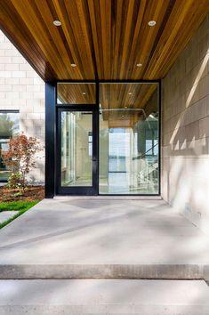 Ottawa River House has a strong indoor-outdoor connection in a picturesque natural setting in Ottawa, Ontario, Canada by Christopher Simmonds Architect. Exterior Doors With Glass, Exterior Front Doors, Glass Front Door, Glass Door, Black Exterior, Front Entry, Modern Exterior, Exterior Design, Entrance Design