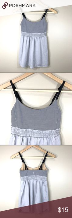Lululemon bliss tank top, size 2 Adorable baby doll style tank top in size 2 from Lululemon. The tank has build in bra but it doesn't come with pads (but you could pick them up at the store for free.) lululemon athletica Tops Tank Tops