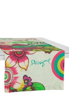 Desigual Tropikal table runner. 100% cotton with a stain resistant finish that protects against dirt and spills (although regular washing is still recommended). Measurements: 50x150cm. / 19.5x58.5