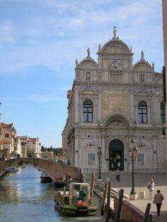 Scuola Grande di San Marco and Garbage Boat Venice Italy