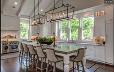 The fixtures, exposed vaulted ceilings, natural light. All white.