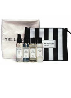 The Laundress Travel Pack -  2 oz Fabric Fresh Classic scent, 2oz Delicate Wash, 2 oz Crease Release, 2 oz Stain Solution, The Laundress Hotel Laundry Bag in a black and white pouch with zipper. Separate your dirty and clean laundry with the washable and reusable Hotel Laundry Bag;