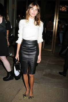 Alexa Chung fashion and style - In a white blouse and a Baukjen leather skirt to an Opening Ceremony event.
