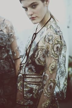 Floral embroidered clear rain mac backstage at MSGM SS15 MFW. More images here: http://www.dazeddigital.com/fashion/article/21857/1/msgm-ss15