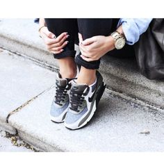 Dress up your workout shoes with some black pants, a chambray top, and a stylish watch.