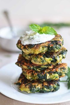 Zucchini, Feta, and Spinach Fritters with Garlic Tzatziki!  Great for appetizers or a light snack, and a fantastic way to sneak in some vegg...