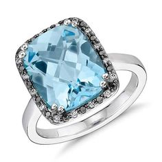 Right hand ring! --  Robert Leser Blue Topaz and Diamond Halo Ring in 14k White Gold from Blue Nile