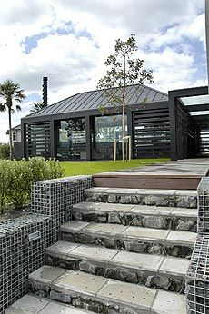 gabion basket walls. I love how their is a light is inside the wall.                                                                                                                                                                                 More