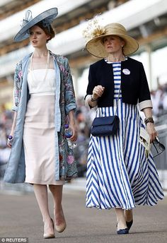 Glamorous racing tans take a stroll through the course