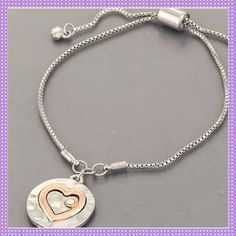 Silver Heart Charm Slide Adjustable Bracelet BEAUTIFUL Rhodium Silver Sliding Charm Bracelet, Silver Disk with Heart Outline done in Gold Tone with Clear Stone, Adjustable Closure to fit most sized wristsPRICE IS FIRM UNLESS BUNDLED Boutique Jewelry Bracelets