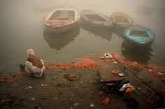 On the banks of the Ganges. India    A sadhu is performing his morning rituals in the Ganga, in Varanasi (Benares). The marigolds used as offerings show that this is an especially holy ghat for the faithful.  http://www.flickr.com/photos/fredcan/3550419515/