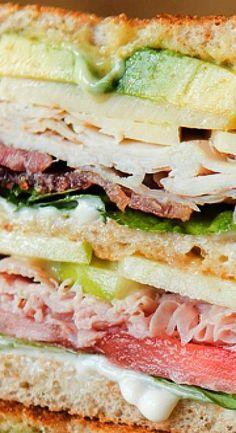 The BEST Triple Decker Club Sandwich; Ham, Turkey, Bacon, Avocado, mayo, tomato...yum!  Try this sandwich on Martin's Whole Wheat Potato Bread!