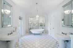 This master bath boasts a gorgeous cast iron pedestal sunken tub.