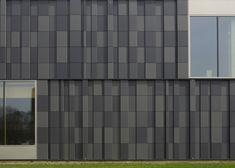 Chequered facade of swimming pool complex by Slangen+Koenis Architecten