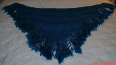 Sapphire blue shawl knitted from home spun yarn.